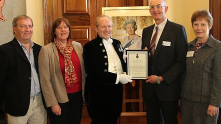 Pictured receiving their award from the High Sheriff of Devon Robin Barlow at County Hall in Exeter