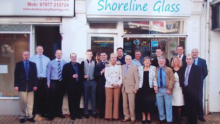 Current staff outside 86 High Street Ilfracombe where it all began.