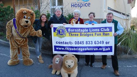 Under starter's roarders! Rory the Lion is pictured with North Devon Hospice's Emma Lowe and Barnsta