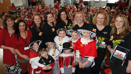 Children in traditional Welsh costume, headteacher Gill Gillett and teaching assistant Claire Colaru