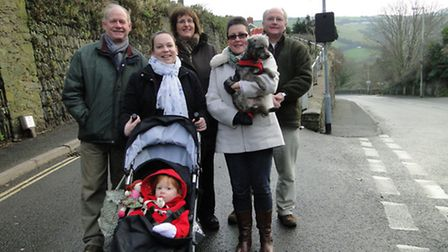 Pictured by the new sign at Hele are Councillor Geoff Fowler, Helen Lewton and daughter Imogen, Kath
