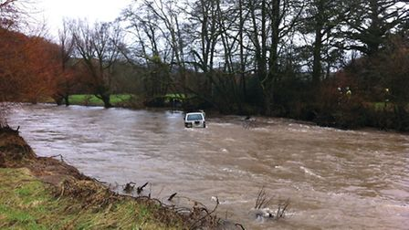 One man had to be rescued from the vehicle stuck in the river. Photo: Graham Rooke.