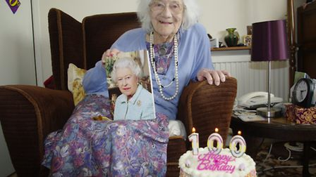 Birthday girl Jessie Prentice with her card from the Queen.