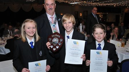 Rotary district governor Graham Smith with the 11-13 winning PIlton Community College team of Lili F