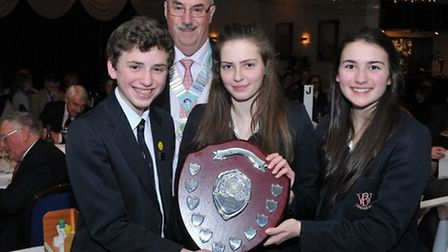 Rotary district governor Graham Smith with the 14-17 winning West Buckland School team of Alex Moore