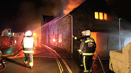 Firefighters battle to contain the fire at Pottington Road, Barnsta[ple, last night (Wednesday). Pic