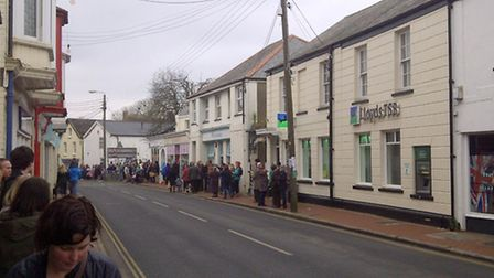 The crowds form in anticipation of the royal visit to Caen Street in Braunton this morning.
