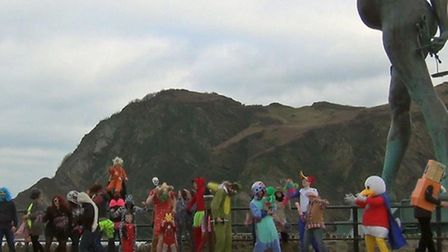 Madcap fun with the Harlem Shake in the shadow of Verity's belly on Ilfarcombe Pier.