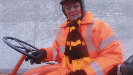 An oily moment raises a chuckle for Mary Phillips during her John O' Groats to Lands End tractor run