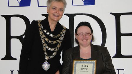 Jenna King, who was nominated nine times, is presented with her Pride in Ilfracombe Award by the May