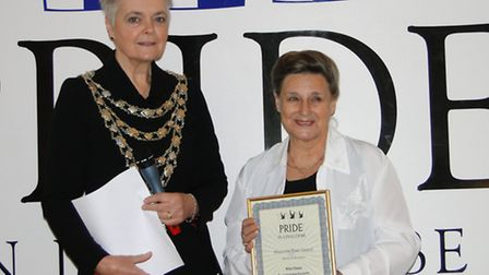 'Queen Victoria' aka Rita Clews collects her length of service Pride in Ilfracombe Award from the Ma