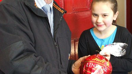Pannier Market manager Simon Curry presenting Bethany Parkhouse with her Easter prize.