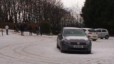 Exmoor Zoo staff work to clear the hail stones away so their visitors can escape the car park.