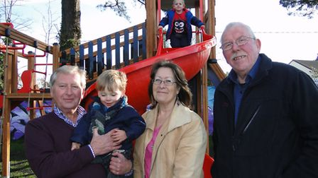 Councillors Rodney Cann, Jackie Flynn and Chris Haywood with young Harry Cann as Archie Reece looks