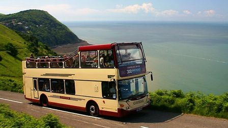 The 300 Coastal Link Lynmouth to Minehead bus pictured on Countisbury Hill.