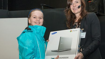 Route 39 Academy logo competition winner Allie Street is presented with her prize by principal Joss