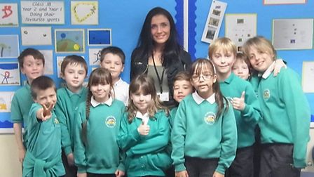 Teaching assistant Claire Colarusso with the Southmead pupils who chatted over the internet to their