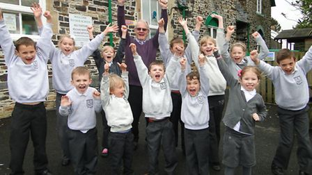 Headteacher Garry Reed and Swimbridge pupils celebrate the school's outstanding Ofsted success.