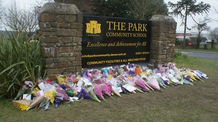 Floral tributes have been left outside Park Community School in Barnstaple.