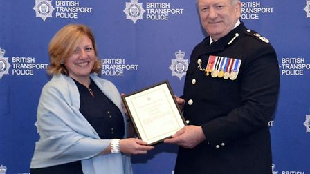 Naomi Spencer is presented with her award by BTP Chief Constable Andrew Trotter.