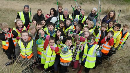 Young 'eco warriors' from Instow Primary School grab their grabbers and vests to help tidy part of t