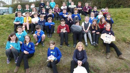 Children from eight different primary schools across the Bideford area pictured before launching the