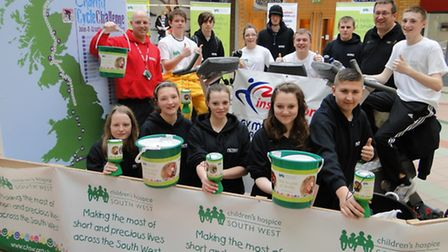 Petroc students and staff, with organiser Steve Warner, help the hospice clock up the miles at Green