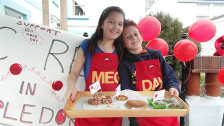 Meg and Daniel Walsh at their cake sale in Appledore.