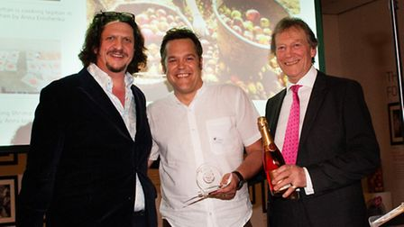 Food critic Jay Rayner and Andy Macdonald, managing director of Coregeo UK, present Guy Harrop with