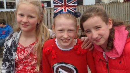 South Molyon pupils (from left): Kamile Sumskyte, Aimee Marrow and Ellie-May King show some St Georg
