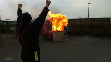 Crew members demonstrated a chip pan fire to the students.