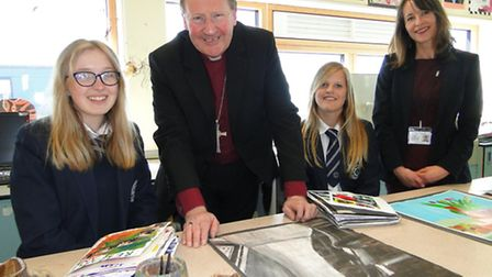 Bishop Michael chats to Year 11 students Sophie Blackmore and Olivia Bridges as headteacher Sharon M
