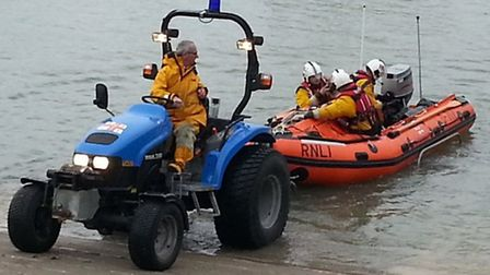 Ilfracombe RNLI volunteers launch the D-class inshore lifeboat Deborah Brown II during the shout yes