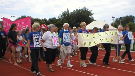 Participants join the Cancer Research UK Relay for Life at Braunton Athletics Track.