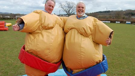 Amigos supporter Dave Butt (left) and Amigos director Phil Pugsley testing out the sumo suits.