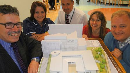 Pictured with the 3D model of the proposed new Chemotherapy Unit in the foyer at North Devon Distric