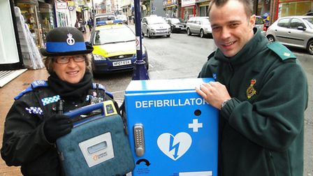 PCSO Karen Grant and Joe Jensen of South Western Ambulance Servcie with the defibrillator, which nee