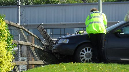 A car crashed into a fence at the McDonald's drive-thru in Barnstaple on Monday morning.