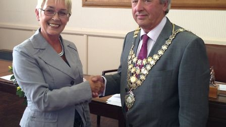 Incoming Mayor of Northam Cllr Barry Mason shakes hands with outgoing mayor Cllr Jane Whittaker.