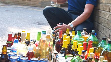 PCSO Alistair Summers is pictured with the confiscated alcohol.