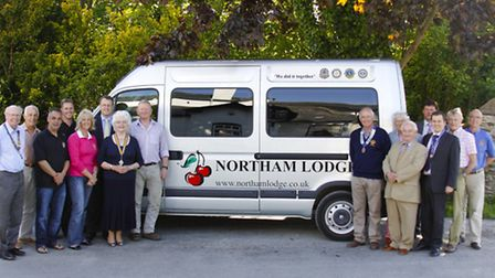 Representatives from each club with the new minibus: From left: Andrew Laughn, Alan Price, Marten St