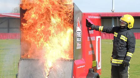 The very explsoive consequnces of putting water on to a chip pan fire is demonstrated to school chil
