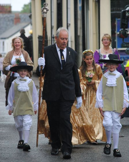 The South Molton Olde English Fayre opening parade makes its way across the Square to open Saturday