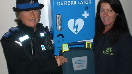 PCSO Karen Grant and Jo Walker of Studio 20 with the newly installed defib box at Market Arches in I