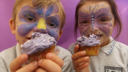 SWIMBRIDGE pupils Louis Gubb and Summer Lakeman go purple for the Chemotherapy Appeal. Their faces w