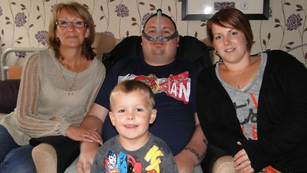 Mik Morgan pictured with mum Annie Allen, wife Jodie and their son Alfie, aged four.