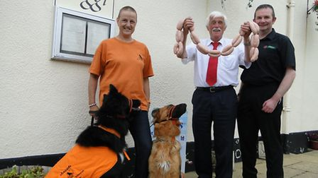 Linda Lines with dogs Jacob and Holly; Tony Reed of Reed's Butchers and Julian Turner, landlord of t