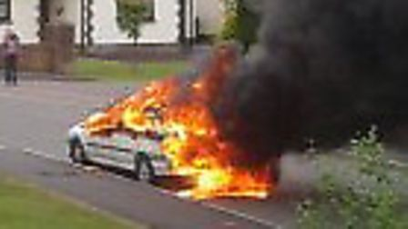 The burning Renault shocked residents at Roundswell this morning (Tuesday) in this picture taken by
