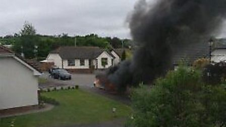 Smoke billows from the burning car at Roundswell this morning (Tuesday) in this picture taken by Ken