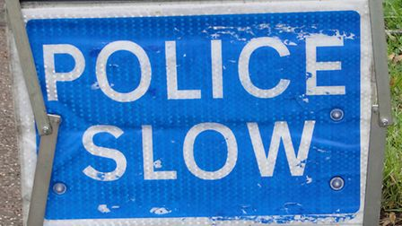 ndg-police-slow-sign-wk26